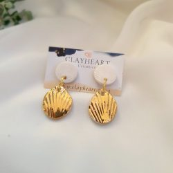 white and gold shell drops